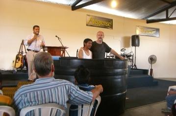 Orphaned young man being baptized at Iglesia Del Camino