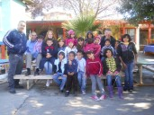 The Board of Directors getting pictures taken with some of the kids and Pastor Jose.