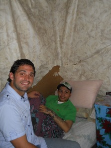 Jesse with Christian; former gang member disabled when shot by police while robbing a bus.